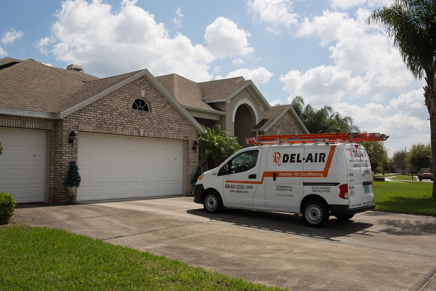 Del-Air van in front of house